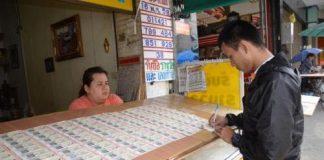 คอหวยเมืองย่าโม ตระเวนหาซื้อเลขเด็ด เลขมงคล ในหลวงร.9